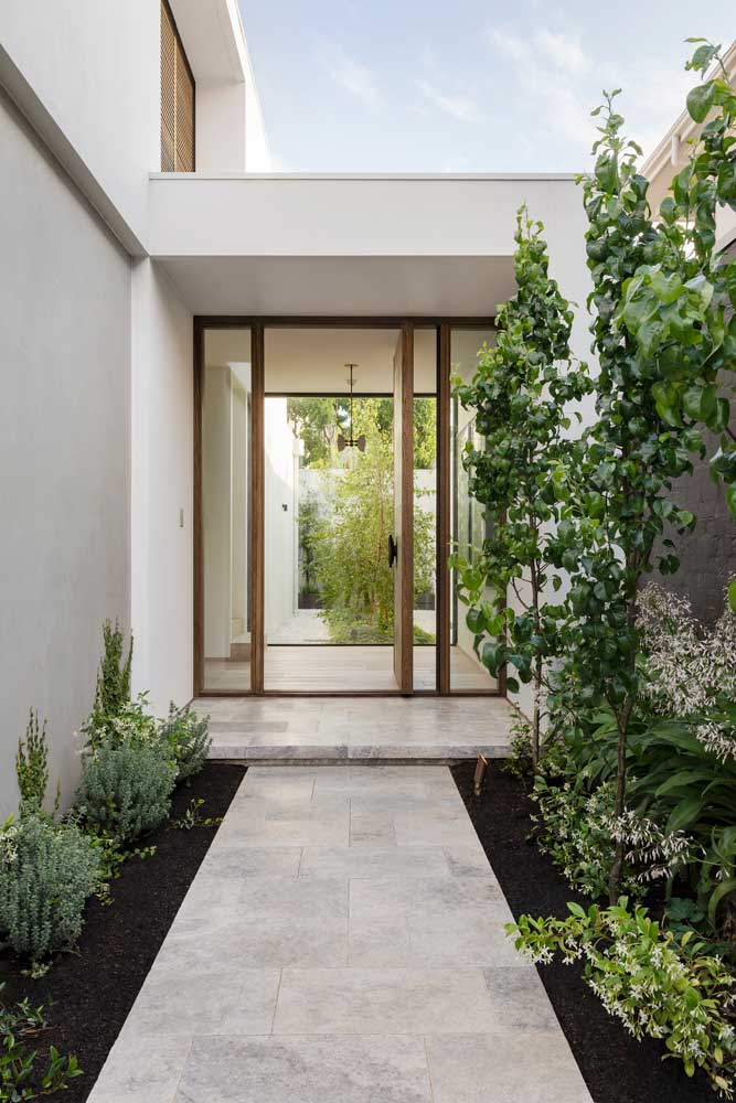 exterior walkway of house with trees and plants